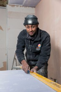Ermias Soloman cutting plasterboard